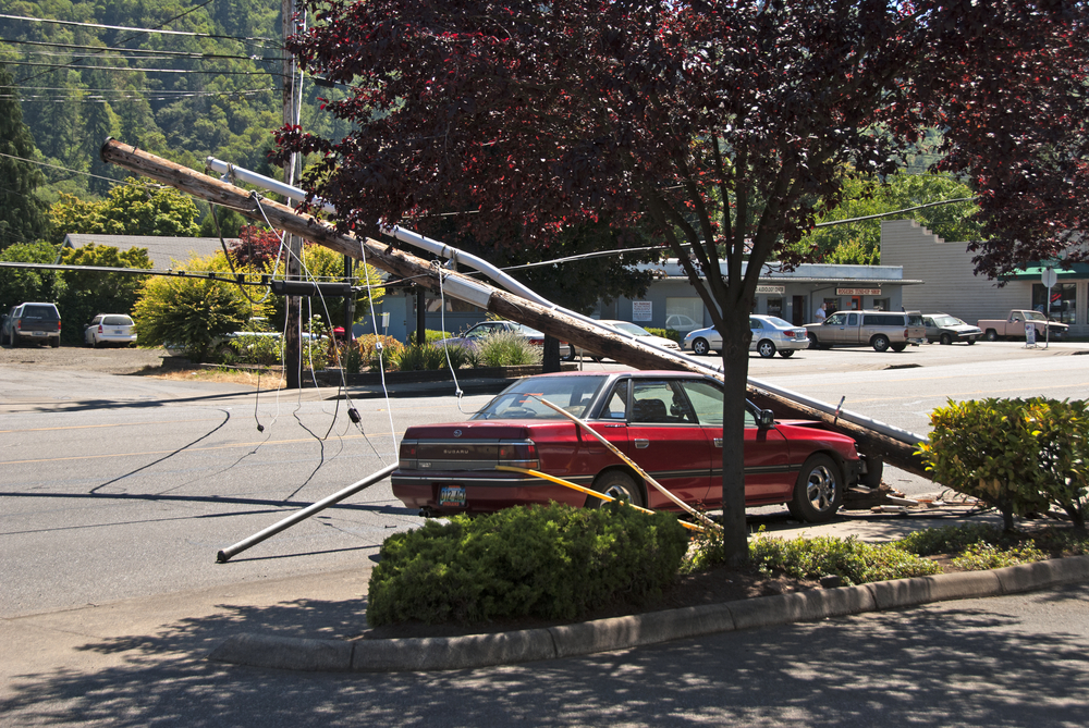 Power pole falls in front of a Southern Maryland residents´car.